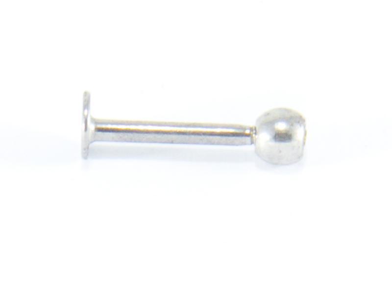 Labret-piercing med grön sten
